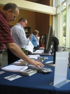 Conference Attendees Pick Up GALILEO Handouts