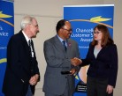 Chancellor Davis presents Customer Service Award to Newspaper Digitization Team