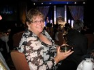 Ruta Abolins Holds the Emmy